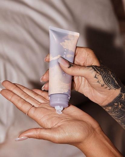 Rihanna applying Fenty Skin hand cream