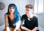 2 young people sitting awkwardly because they have a quincunx in their birth chart, which could be t...