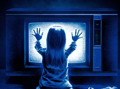 The cover of the 1982 horror film, 'Poltergeist', with Heather O'Rourke placing her hands on a telev...