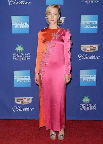 Saoirse Ronan wears a Gucci gown.