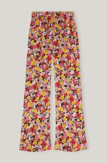 GANNI's floral-printed satin elastic pants.