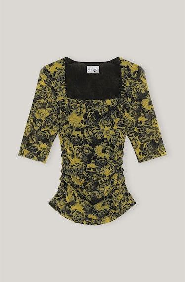 GANNI's printed mesh blouse.