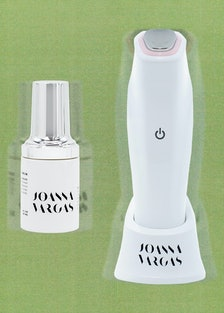 a bottle of Joana Vargas serum and an electronic skincare device