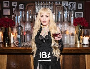 Madonna holding a vodka drink.
