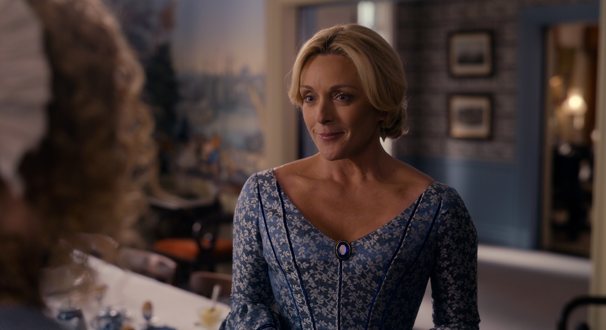 Jane Krakowski smiling as Mrs. Dickinson