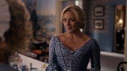 Jane Krakowski smiling as Mrs. Dickinson