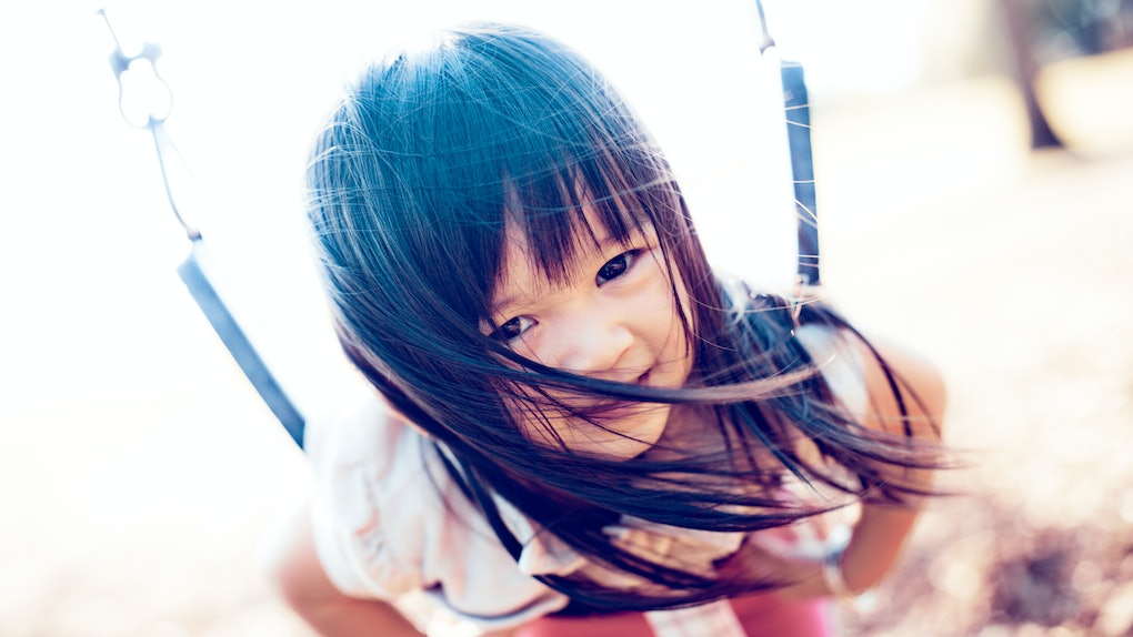 Picture of Asian baby in swing