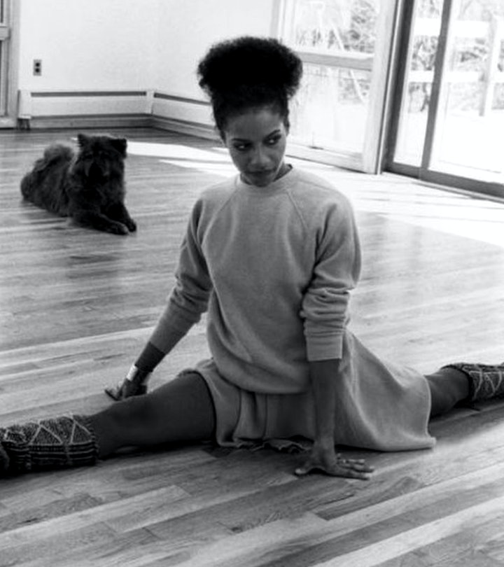 The focus of 'Hot Chocolate Nutcracker,' Debbie Allen stretches in her dance studio with her dog in 1982.
