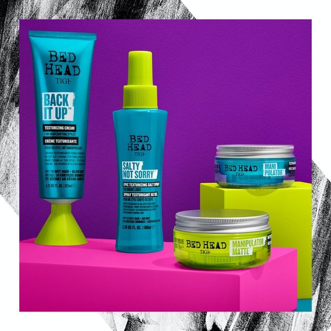 Four out of six new Bed Head by TIGI hair products against a pink and purple back drop.