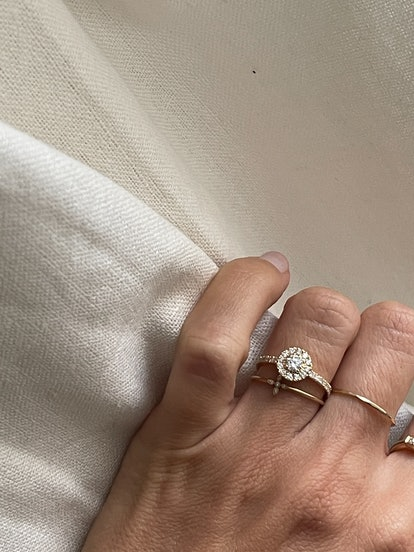 Halo settings are a popular French engagement ring style, as seen on Anne-Laure Mais Moreau.