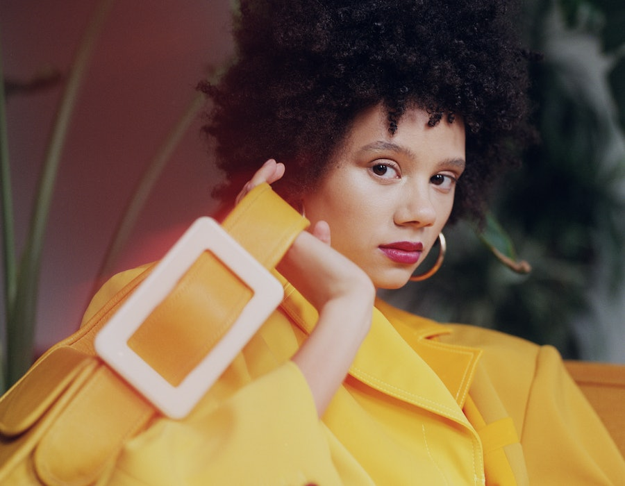 Model wearing yellow outfit and carrying yellow bag for EDAS.