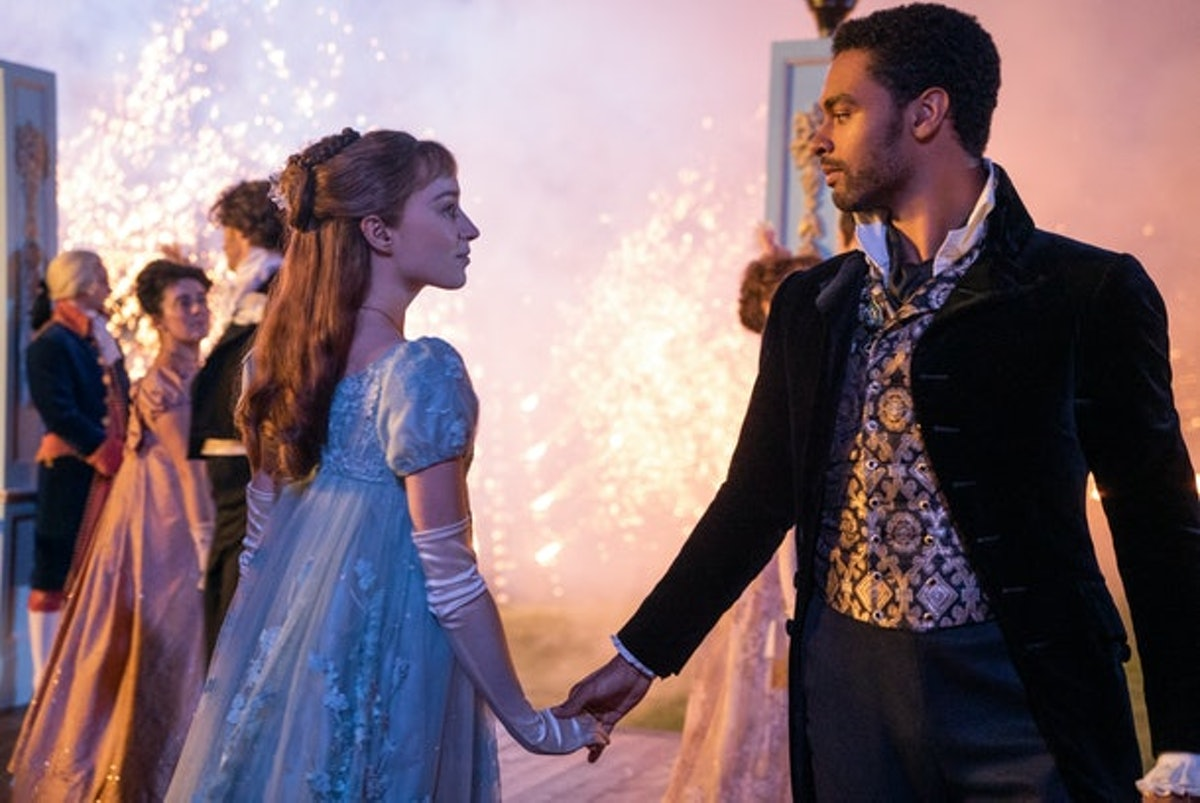 Daphne and Simon from 'Bridgerton' look into each other's eyes and dance at a lavish ball.