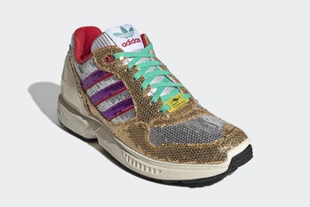 Sneaker covered in gold and silver sequins with green laces