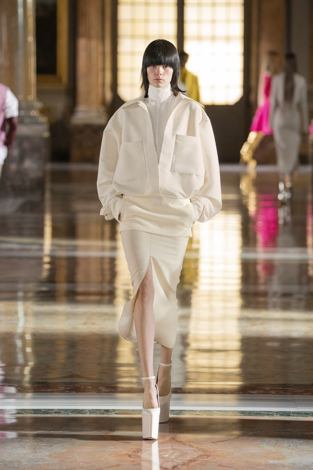 Model wears white platforms while walking during Valentino's Spring 2021 Couture show.