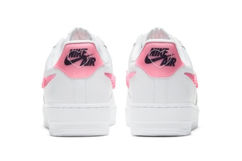 Pink heels with Nike branding and heart