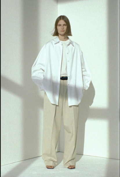 The Row spring/summer 2021 collection with model wearing white shirt and chino pants