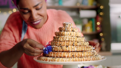 Nadiya makes a celebration cake in 'Nadiya Bakes' via Netflix press site.