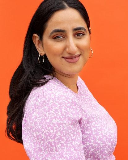 founder Priyanka Ganjoo's portrait wearing a lilac floral top
