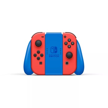 The latest and limited edition of Mario-themed Switch from Nintendo is placed on a white surface in front of a white background. The prominent colors in this Switch edition are bold red and blue.