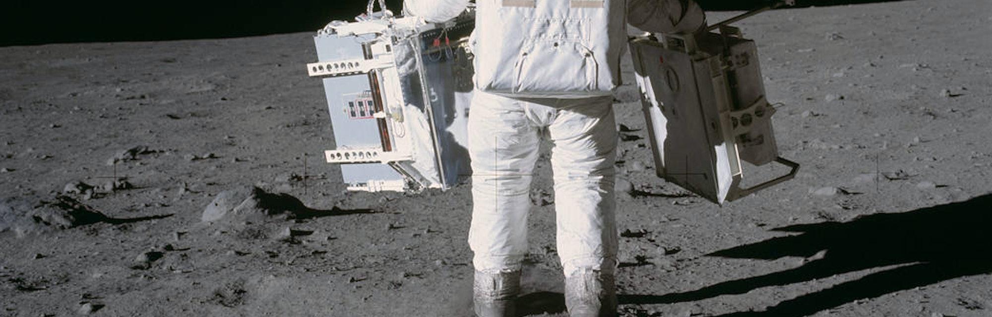 NASA astronaut hiking on the Moon