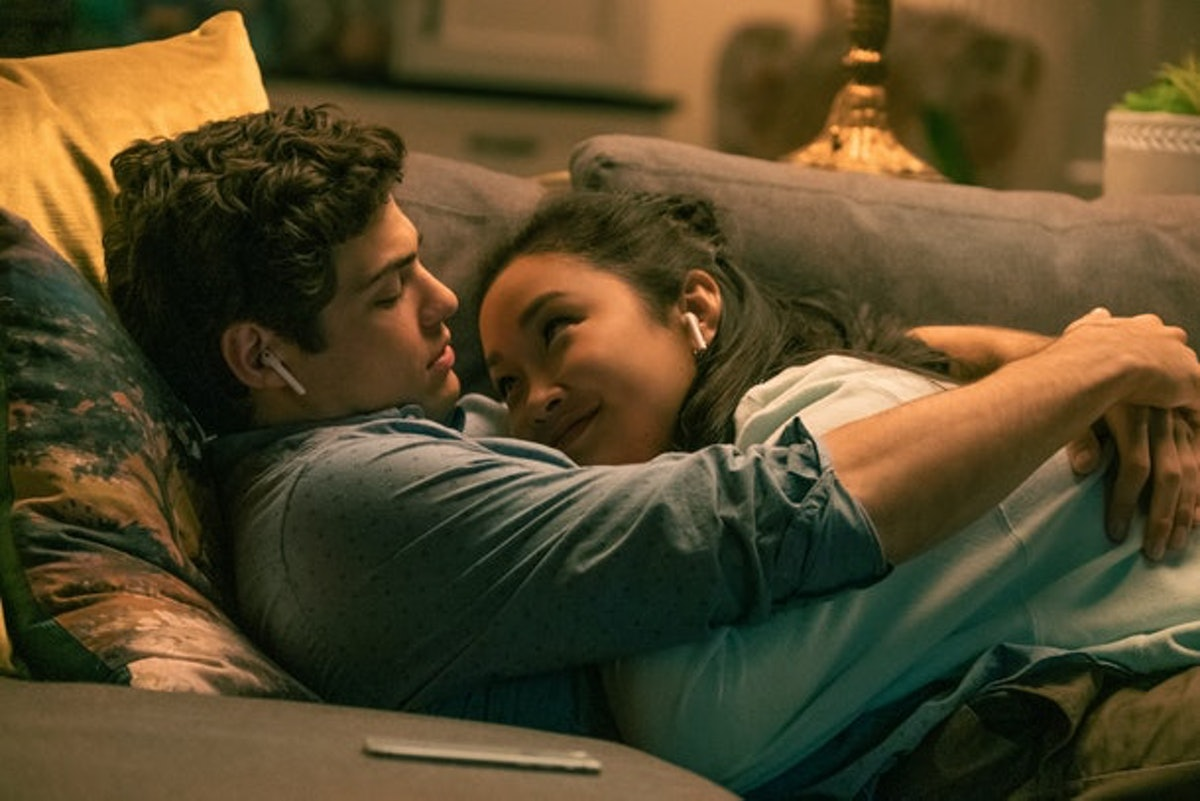 Lara Jean and Peter K in 'TATB' cuddle up on the couch while listening to music.