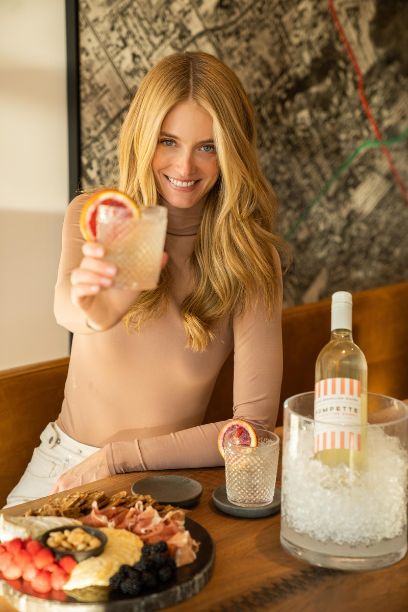 Kate Bock poses with Pompette Beverages. Photo via Pompette