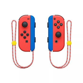 The Joy-Cons for the Mario-themed Nintendo Switch can be seen suspended in the air. The external part of the Joy-Con is bold red. The internal part is blue.