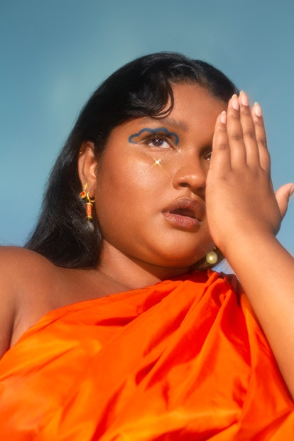 South Asian model with a blue eyeliner design