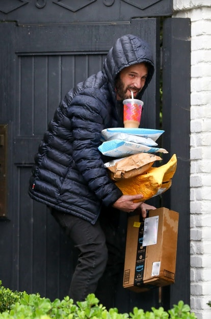 Ben Affleck carrying packages and Dunkin Donuts coffee