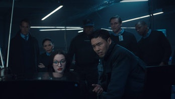Kat Dennings as Dr. Darcy Lewis and Randall Park as Jimmy Woo in WandaVision Episode 4