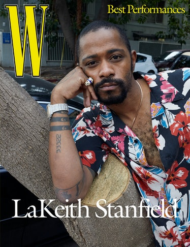 Stanfield wears a Saint Laurent by Anthony Vaccarello shirt; Cartier ring and his own Cartier watch;...