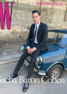 Baron Cohen wears a Prada suit, shirt, and tie; Falke socks; Manolo Blahnik shoes; his own ring.