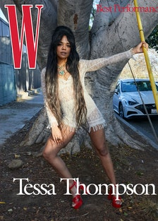 Thompson wears a Dior romper, bralette, and briefs; Cartier necklace and ring; Giuseppe Zanotti shoe...