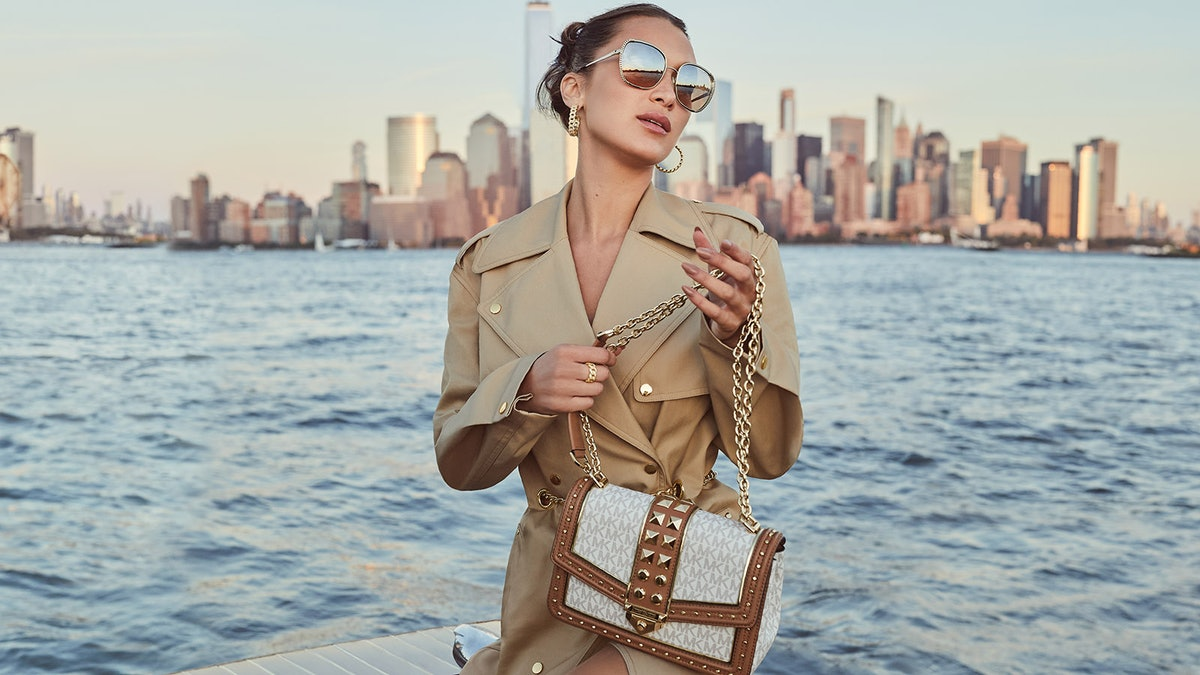 Bella Hadid appears in MICHAEL Michael Kors Spring/Summer 2021 campaign.