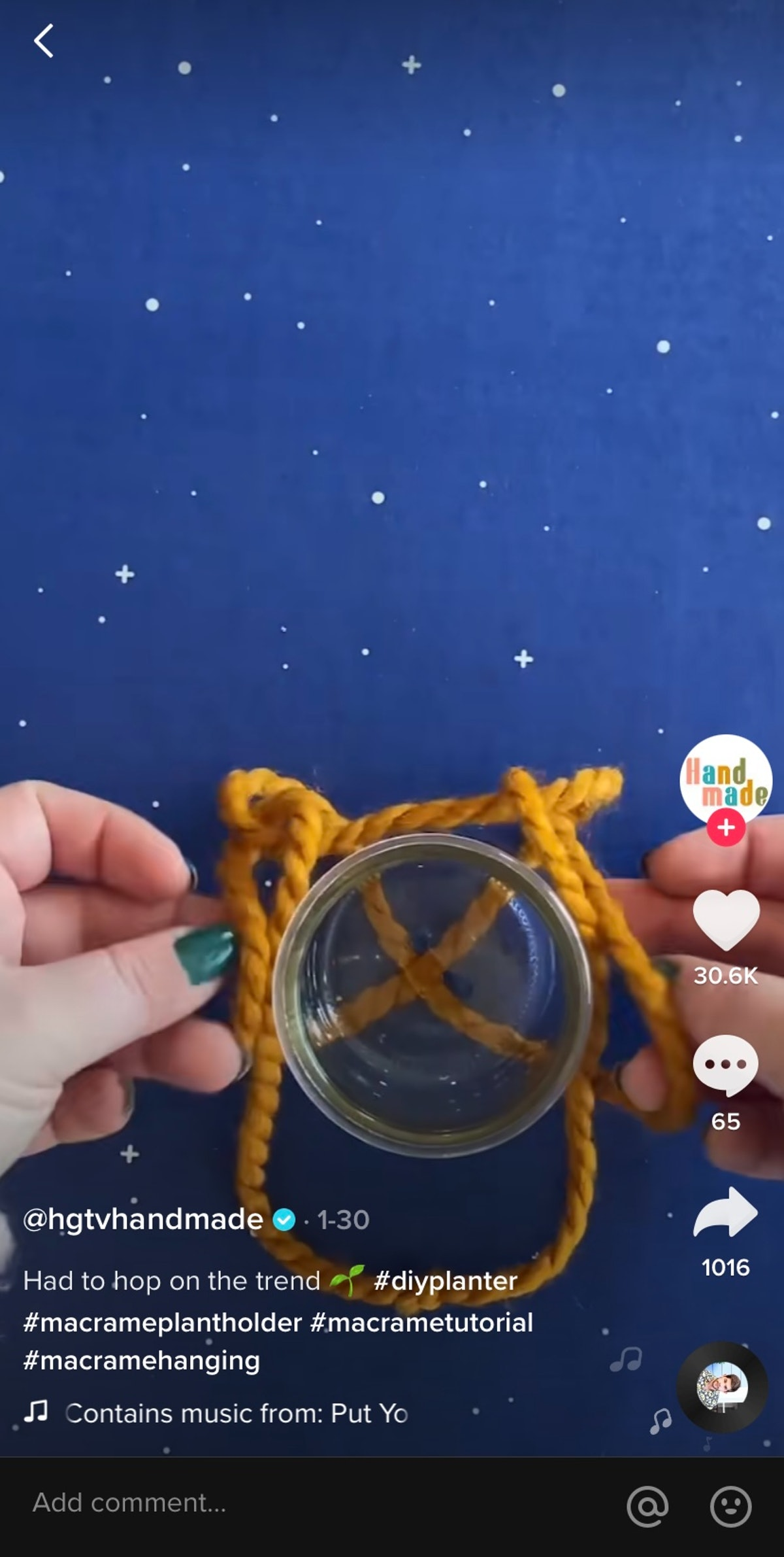 A TikTok user folds a yellow rope while making a macrame plant hanging on the app.
