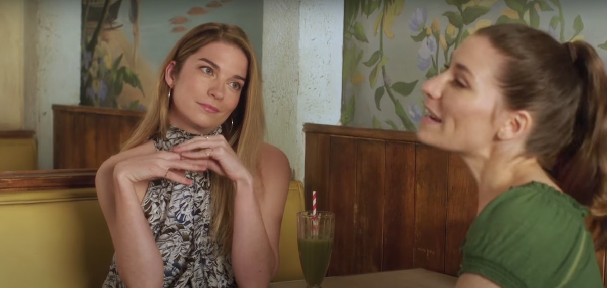Twyla and Alexis gossip and talk dating tips at Café Tropical in 'Schitt's Creek.'