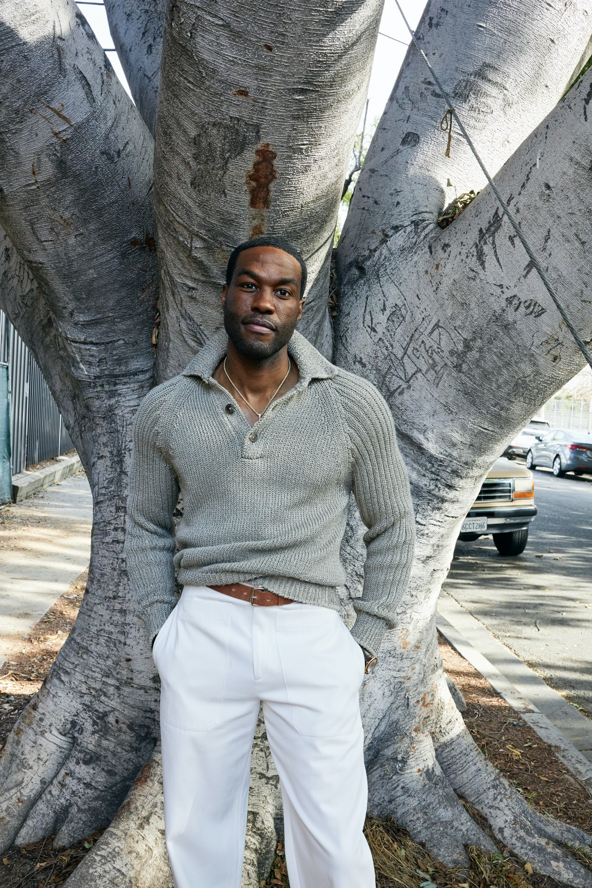 Yahya Abdul-Mateen II wears an Hermès sweater, pants, and belt; Cartier watch; his own necklace.