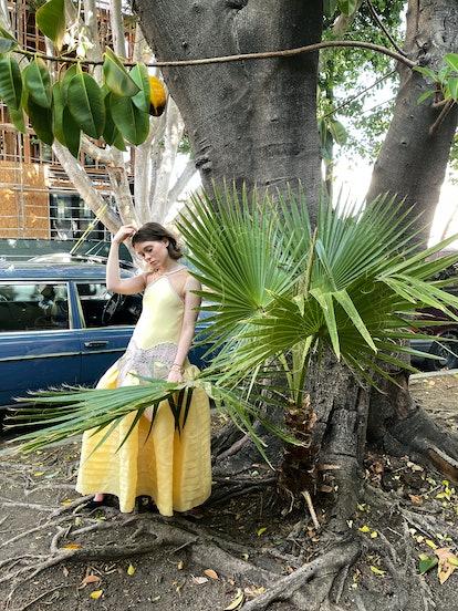 Sophia Lillis wears a Lanvin dress; Cartier bracelet and watch; Manolo Blahnik shoes.