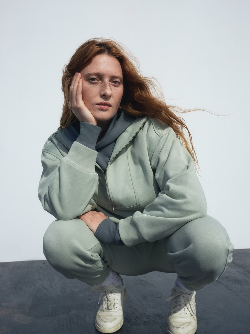 Model appears in an ad for Everlane track collection.