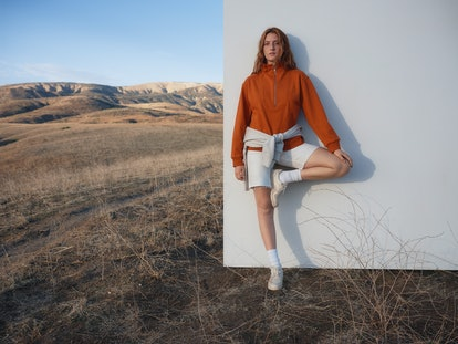 Model wears clothing from Everlane's Track Collection.