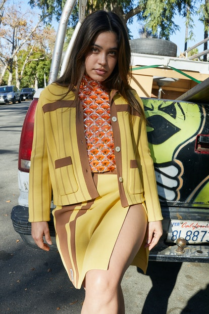 Otmara Marrero wears a Miu Miu jacket, halter  top, and skirt.