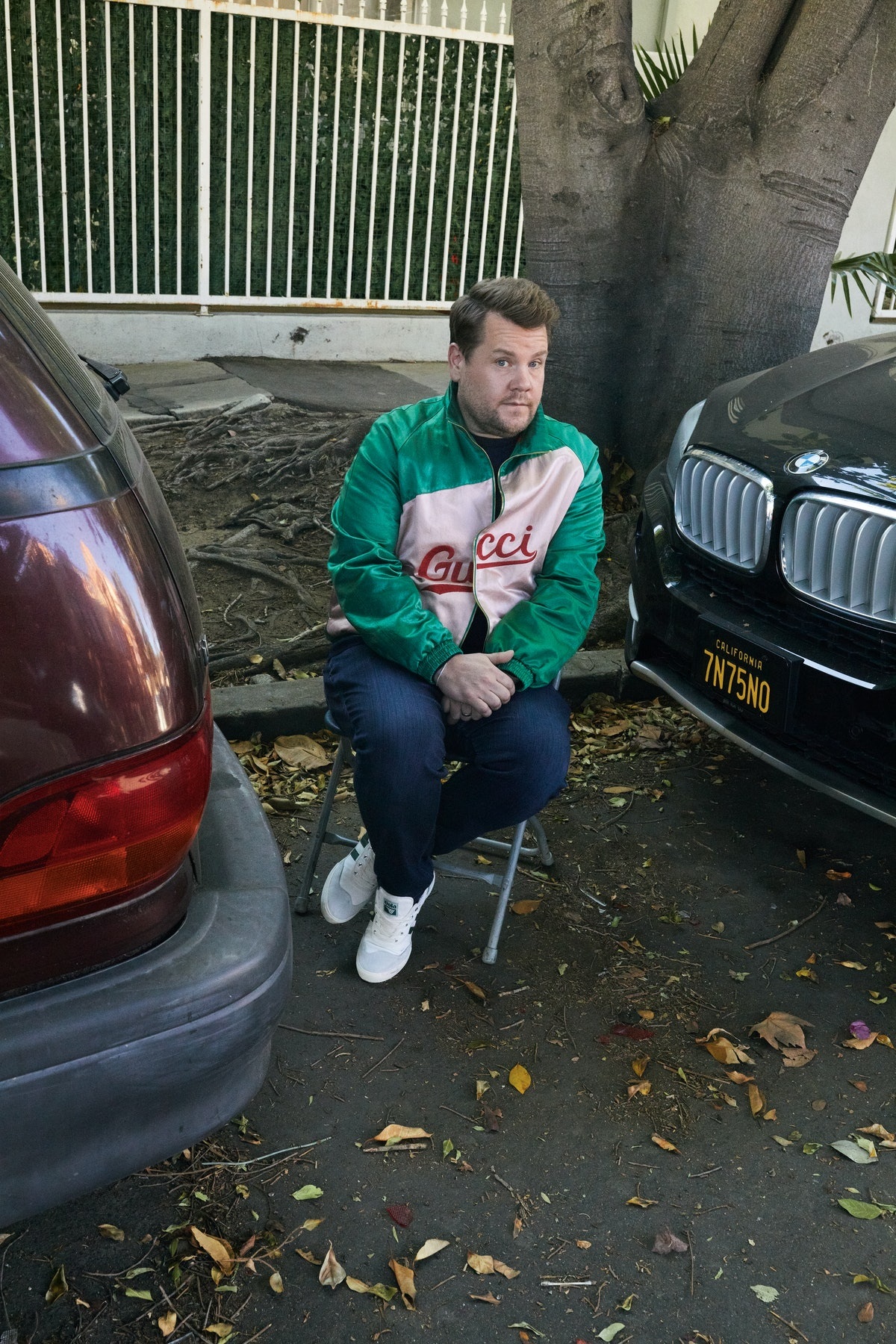 James Corden wears a Gucci jacket and sweater; Gola sneakers;  his own jeans and ring.