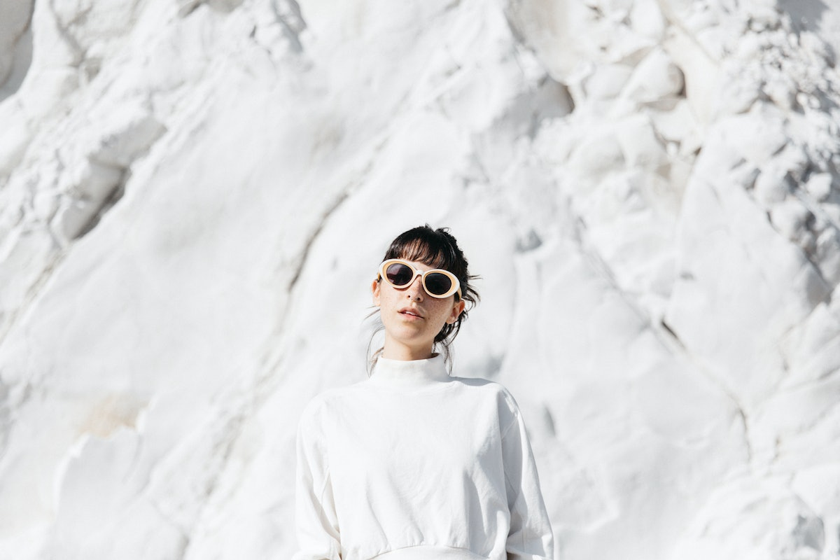 Snow puns, woman in front of snow