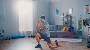 Man exercising at home.