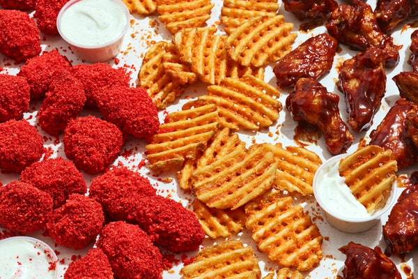 Applebee's just launched an online-only concept selling Cheetos-covered chicken wings.