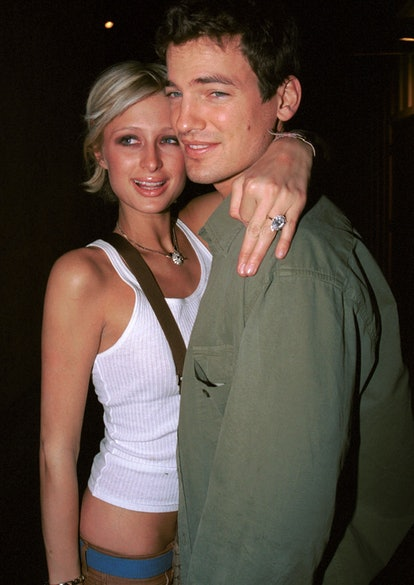 """Model Paris Hilton and her then-fiance Jason Shaw, embrace at """"The Lounge"""" March 8, 2002 in West Hollywood, CA."""