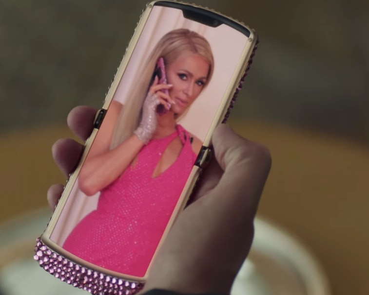 Paris Hilton is seen on a Razr screen talking to comedians for a Christian Cowan ad.