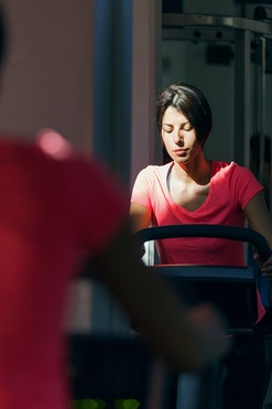 closeup of woman on exercise bike