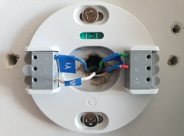 Nest Thermostat mounting plate on a wall.