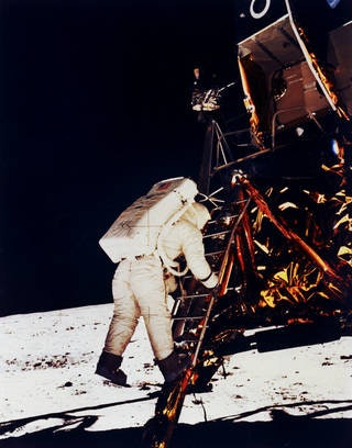 Aldrin climbs down Apollo lander to Moon